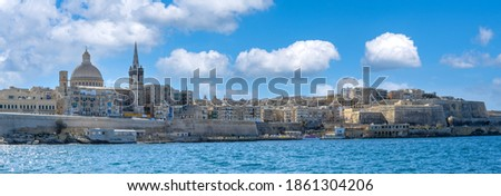 Panoramaof Valletta from the seafront showing the dome of the Basilica of Our Lady of Mount Carmel and St Paul's Pro-Cathedral. Stock photo ©