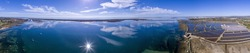 Panoramic aerial cloud seascape, in Ria Formosa wetlands natural park, over Cavacos beach. Algarve. Portugal.