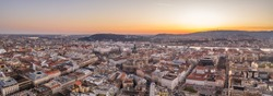 Panoramic aerial drone shot of east facade of St. Stephen's Basilica in Budapest sunrise morning glow
