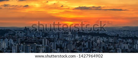 Panoramic Aerial Image of a Beautiful Orange Sunset Sky over Belo Horizonte City seen from Water Tank Belvedere