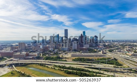 Panoramic aerial view Downtown with Interstate 10, 45 and Gulf freeway intersection. Massive highway, stack interchange, viaduct and elevated road junction overpass from Northeast Houston, Texas, USA.
