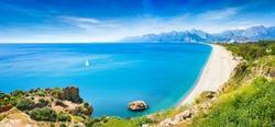 Panoramic aerial view of beautiful blue gulf and long Konyaalti beach in Antalya, Turkey. Antalya is Turkey's biggest international sea resort located on Turkish Riviera.