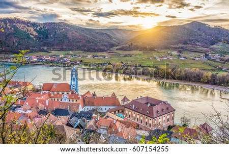 Panoramic aerial view of beautiful Wachau Valley with the historic town of Durnstein and famous Danube river in beautiful golden evening light at sunset, Lower Austria region, Austria Stock fotó ©