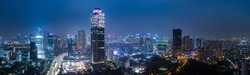 PANORAMIC Aerial View of Jakarta Downtown Skyline with High-Rise Buildings at Sunset, Indonesia, Asia