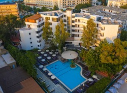 Panoramic aerial view of large swimming pool with bar at luxury tropical hotel apartment resort. Rhodes, Greece, Europe