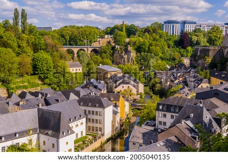 Panoramic aerial view of Luxembourg-City with Grund, Alzette river, and modern buildings in the background Stock photo ©