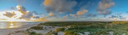 Panoramic aerial view of Lyngvig lighthouse on wide dune of Holmsland Klit with beach view on the west coast of Jutland, by Hvide Sande, Denmark