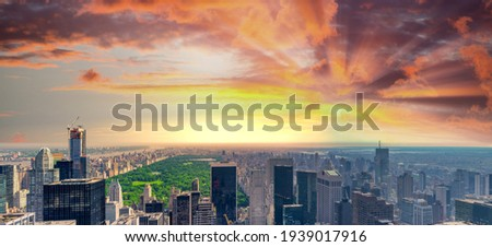 Panoramic aerial view of New York City skyline and Central Park.