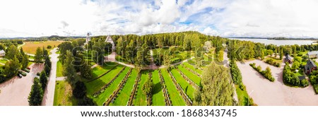 Panoramic aerial view of old medieval stone church of St. Mary and cemetery in Hollola, Finland stock photo