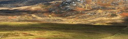 Panoramic aerial view of rocky shores, valleys and hills of isle of Islay. Inner Hebrides, Argyll and Bute, Scotland, UK. Nature, travel destinations, ecotourism, hiking, environmental conservation