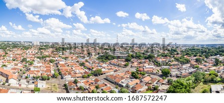 Photo of  Panoramic aerial view of the Autonomist neighborhood and surroundings, at the city of Campo Grande MS, Brazil. Capital of Mato Grosso do Sul state. Low density area, wooded city in development.