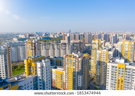 Panoramic aerial view of the city with multi storey residential buildings and highways Сток-фото ©