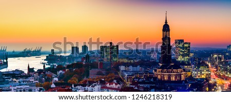 Panoramic aerial view of the harbor, St. Michael\'s Church (German: St. Michaelis) and downtown Hamburg, Germany.