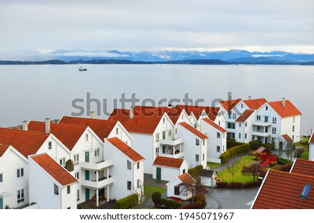 Panoramic aerial view of the yacht marina, modern traditional houses with tiled roofs, falu red dye. Stavanger, Rogaland region, Norway. Architecture, travel destinations, tourism, sailing, cruise Stock fotó ©