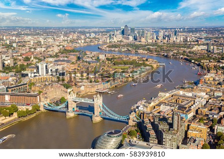 Panoramic aerial view of Tower Bridge in London in a beautiful summer night, England, United Kingdom #583939810