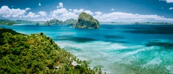 Panoramic aerial view of tropical Palawan island with unique Pinagbuyutan island on horizon. El Nido-Philippines Southeast Asia Bacuit archipelago