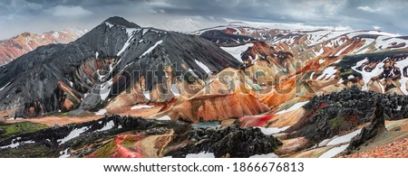 Panoramic amazing Icelandic landscape of colorful rainbow volcanic Landmannalaugar mountains, at famous Laugavegur hiking trail with dramatic snowy sky, and red volcano soil in Iceland. Photo stock ©