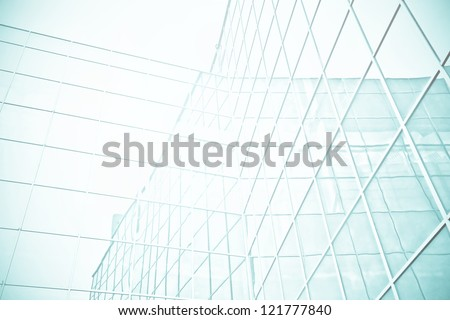 Panoramic and perspective wide angle view to steel blue background of glass high rise building skyscrapers in modern futuristic downtown at night