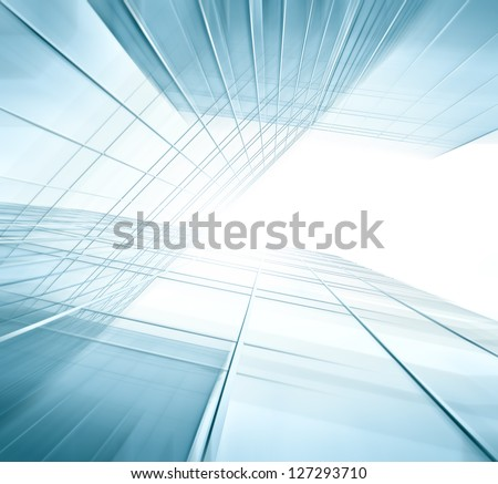 Panoramic and perspective wide angle view to steel blue background of glass high rise building skyscrapers in modern futuristic downtown at night Business concept of successful industrial architecture #127293710