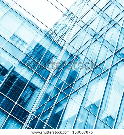 Panoramic and perspective wide angle view to steel blue background of glass high rise building skyscrapers in modern futuristic downtown at night Business concept of successful industrial architecture #150087875