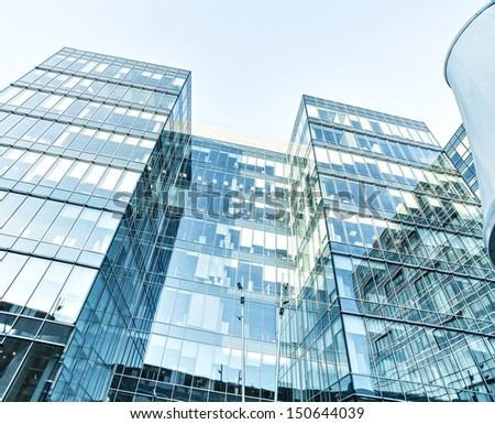 Panoramic and perspective wide angle view to steel blue background of glass high rise building skyscrapers in modern futuristic downtown over sky Business concept of successful industrial architecture Photo stock ©