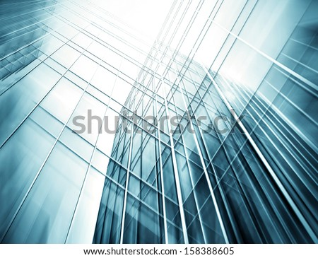 Panoramic and perspective wide angle view to steel blue background of glass high rise building skyscrapers in modern futuristic downtown at night Business concept of successful industrial architecture #158388605
