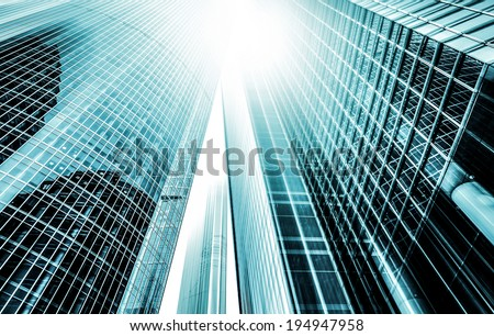 Panoramic and perspective wide angle view to steel light blue background of glass high rise building skyscraper commercial modern city of future. Business concept of successful industrial architecture #194947958
