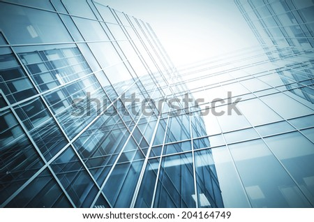 Panoramic and perspective wide angle view to steel light blue background of glass high rise building skyscraper commercial modern city of future. Business concept of successful industrial architecture #204164749