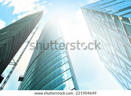 Panoramic and perspective wide angle view to steel light blue background of glass high rise building skyscraper commercial modern city of future Business concept of success industry tech architecture