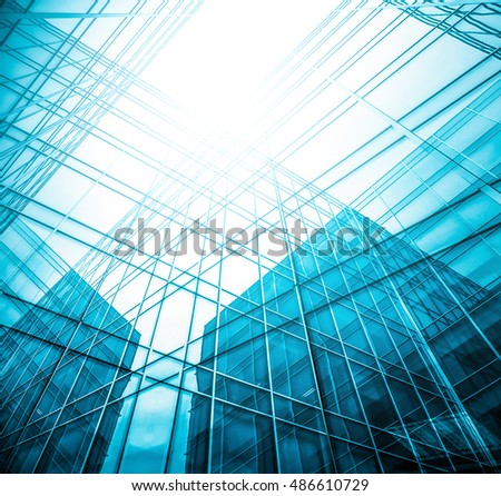 Panoramic and perspective wide angle view to steel light blue background of glass high rise building skyscraper commercial modern city of future. Business concept of success industry tech architecture #486610729