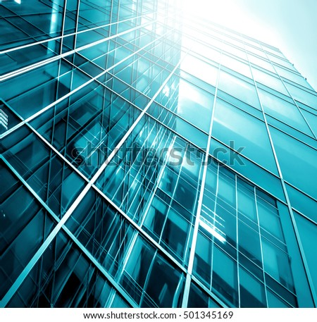 Panoramic and perspective wide angle view to steel light blue background of glass high rise building skyscraper commercial modern city of future. Business concept of success industry tech architecture #501345169