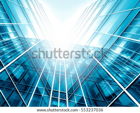 Panoramic and perspective wide angle view to steel light blue background of glass high rise building skyscraper commercial modern city of future. Business concept of success industry tech architecture #553237036