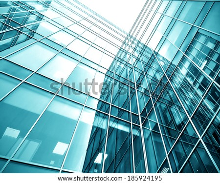 Panoramic and prospective wide angle view to steel light blue background of glass high rise building skyscraper commercial modern city of future. Business concept of successful industrial architecture #185924195