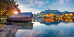 Panoramic autumn view of Altaussee village. Perfect evening scene of Altausseer lake with two ducks. Wonderful landscape of Austria, Europe. Traveling concept background.
