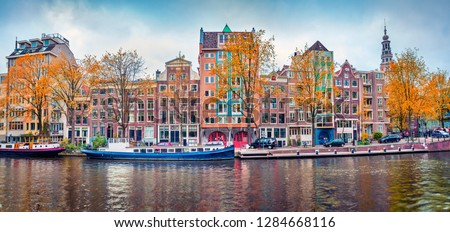 Panoramic autumn view of Amsterdam city. Famous Dutch channels and great cityscape. Splendid morning scene of Netherlands, Europe. Traveling concept background. Stockfoto ©