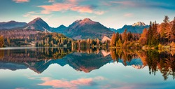 Panoramic autumn view of Strbske pleso lake. Calm morning scene of High Tatras National Park, Slovakia, Europe. Beauty of nature concept background.