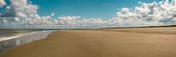 Panoramic beach view with clouds Zeeland the Netherlands