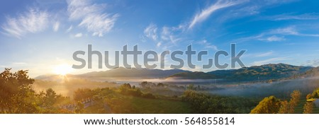 Panoramic beautiful Misty Morning with Beautiful Sunrise which clear blue sky in morning at Doi Mae Salong, Chiang Rai, Thailand. #564855814