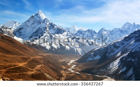 Panoramic beautiful view of mount Ama Dablam with beautiful sky on the way to Everest base camp, Khumbu valley, Sagarmatha national park, Everest area, Nepal #336437267