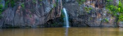 Panoramic beautiful waterfall and rock cliff in deep forest at Thailand
