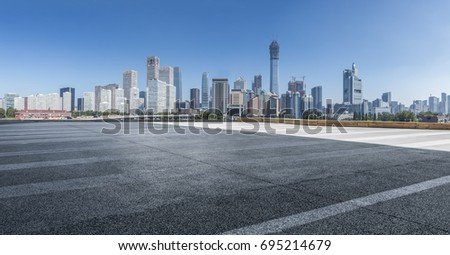 Panoramic beijing skyline and buildings with empty road