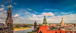 Panoramic bird view of beautiful Dresden cityscape with red roofs, blue sky and clouds at sunset, Dresden, Germany, summer