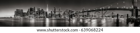 Shutterstock Panoramic Black and white view of Lower Manhattan Financial District skyscrapers at twilight with the Brooklyn Bridge and East River. New York City