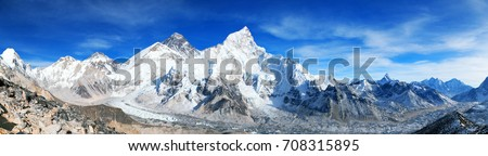 Panoramic blue colored view of himalayas mountains, Mount Everest and Khumbu Glacier from Kala Patthar - way to Everest base camp, Khumbu valley, Sagarmatha national park, Nepalese himalayas