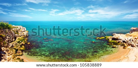 Panoramic blue lagoon, clear waters of Mediterranean sea, romantic island with peaceful sandy beach, bird eye panorama of coastal bay, beautiful seascape, ocean landscape, summer vacation and travel