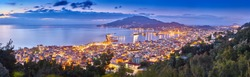 Panoramic city and port view on the island of Zakynthos, Greece. Incredibly romantic sunrise on Zakinthos. Amazing sunset view on Zante town with multicolored clouds. Street lights. Port with ferries.