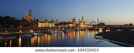 Panoramic city landmark in night with elbe river scene in Dresden, Germany.