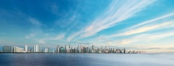 Panoramic City  landscape with cloudy blue sky over the deep blue sea. Sunrise  over the cityscape view. City urban Landscape.