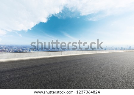 Panoramic city skyline and buildings with empty asphalt road