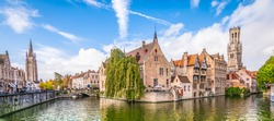 Panoramic city view with Belfry tower and famous canal in Bruges, Belgium.